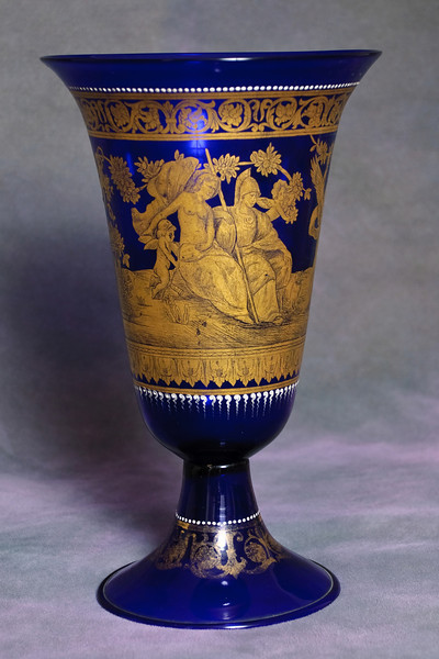 Tall vase, thin glass very light. Possible gold gilding and white enamel applied. Next 3 photos are from other angles.