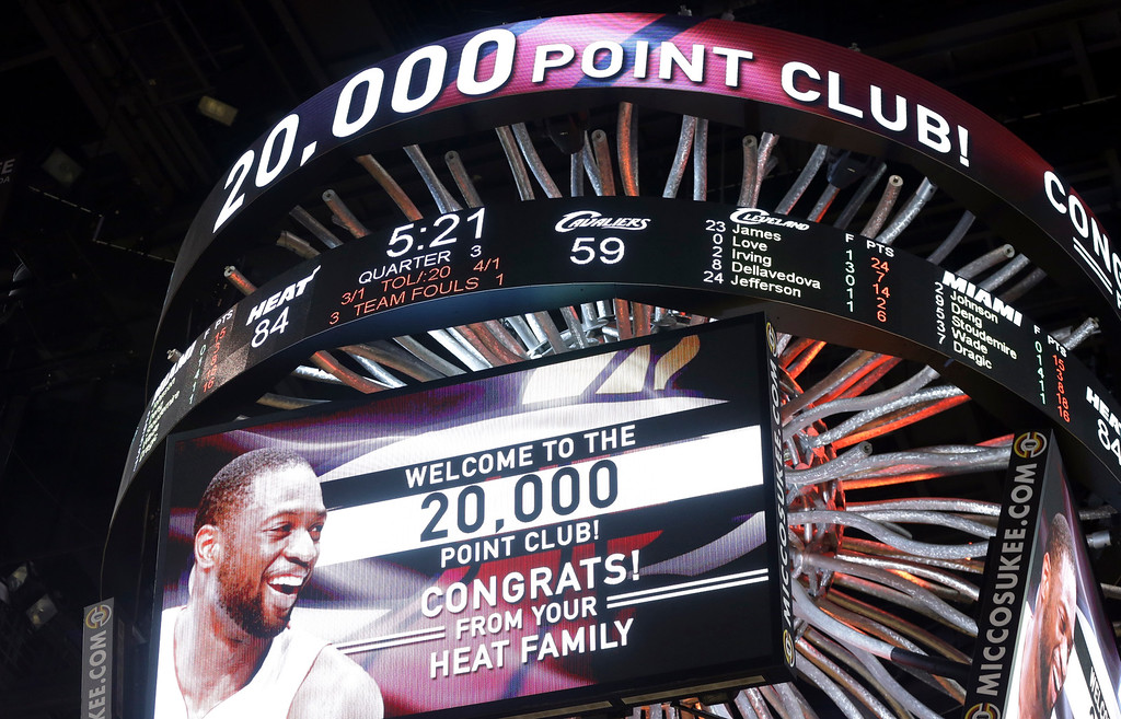 . The scoreboard displays 20,000 career points scored by Miami Heat guard Dwyane Wade during the second half of an NBA basketball gam against the Cleveland Cavaliers, Saturday, March 19, 2016, in Miami. (AP Photo/Lynne Sladky)