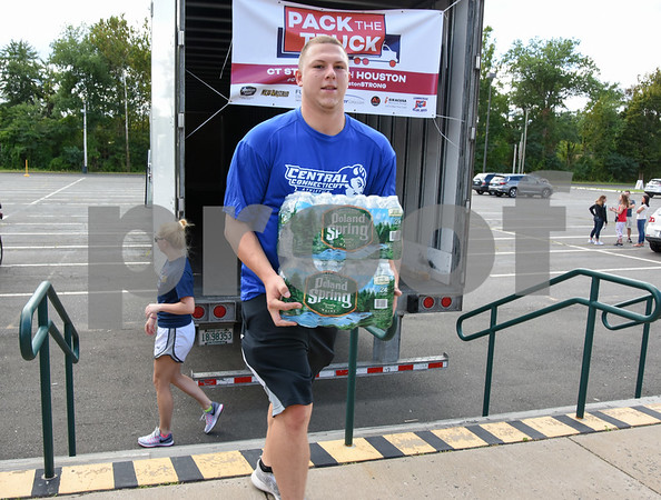 09/08/17 Wesley Bunnell | Staff A Pack the Truck event for Hurricane Harvey relief took place on Friday afternoon in the parking lot at New Britain Stadium. The event was a partnership between the New Britain Bees, Houston Astros outfielder George Springer, Siracusa Moving and Storage, A1 Automotive Repair, the Connecticut Blue Jays AAU Travel Team and Premier Limousine with trucks from Siracusa leaving for Houston following the event. CCSU student athletes volunteered to help unload donations.