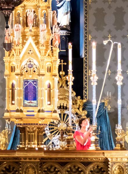 620 1229 IMG_0236 3 lighting candels N D Basilica.jpg