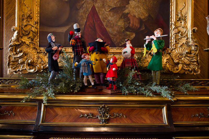 . Figurines of carolers adorn a prized rolltop desk in the Governor\'s mansion library. Photo by Mark Broste