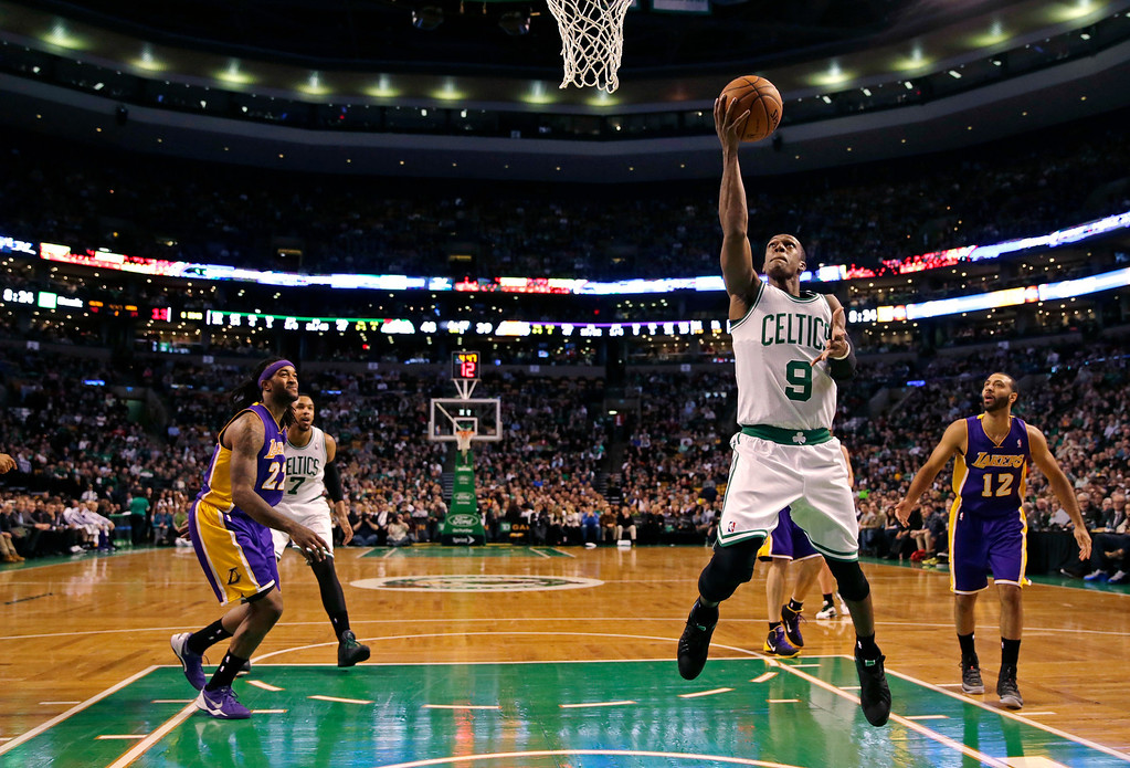 . Boston Celtics guard Rajon Rondo (9) drives to the basket against the Los Angeles Lakers9during the second quarter of an NBA basketball game in Boston, Friday, Jan. 17, 2014. Rondo returned to the court for the first time this season, after undergoing surgery on his right knee. (AP Photo/Charles Krupa)