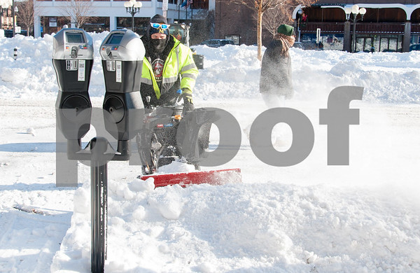 01/05/18 Wesley Bunnell   Staff City workers cleared out Central Park on Friday morning following Thursday's blizzard. Dan Cummings works on clearing up parking around the park.