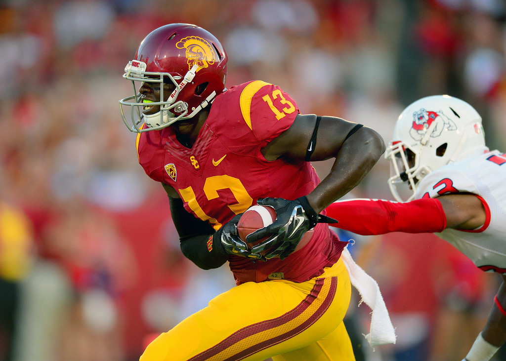. USC TE Bryce Dixon scores on a 22-yard pass reception behind Fresno State\'s Bryan Harper in the third-quarter, Saturday, August 30, 2014, at the L.A. Memorial Coliseum. (Photo by Michael Owen Baker/Los Angeles Daily News)