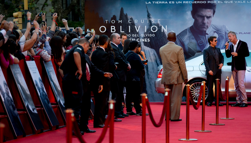 ". U.S. actor Tom Cruise, second right, arrives at a presentation to promote his film ""Oblivion\"" in Buenos Aires, Argentina,  Tuesday, March 26, 2013. (AP Photo/Natacha Pisarenko)"