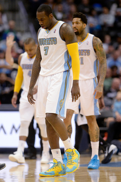. J.J. Hickson (7) of the Denver Nuggets and the Nuggets walk off the court during a break against the Minnesota Timberwolves in the second quarter at the Pepsi Center.  (Photo By AAron Ontiveroz/The Denver Post)