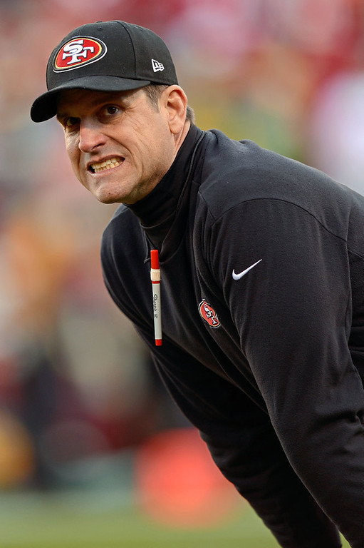 . Head coach Jim Harbaugh of the San Francisco 49ers looks on prior to the NFC Divisional Playoff Game against the Green Bay Packers at Candlestick Park on January 12, 2013 in San Francisco, California.  (Photo by Thearon W. Henderson/Getty Images)