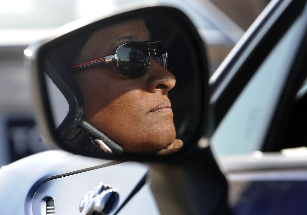 . Rosamond, Calif., -- 03-23-13-  Toyota Pro/ Celebrity Race participant actress and comedian  Wanda Sikes, reflected in the side mirror of her race car,  during a practice session at Willow Springs Raceway. The Toyota Pro/Celebrity Race helps raise money on behalf of Racing for Kids, a fundraising program benefiting Miller Children�s Hospital in Long Beach and Children�s Hospital of Orange County. On behalf of the race and its participants, Toyota has donated more than $2 million to various children�s hospitals since 1991.  Stephen Carr/  Los Angeles Newspaper Group