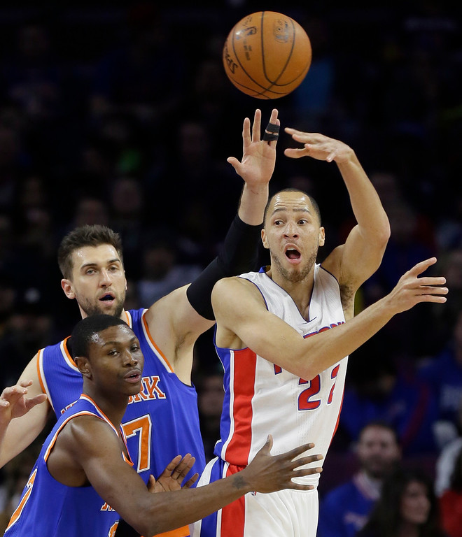 . Detroit Pistons forward Tayshaun Prince passes the ball while defended by New York Knicks forward Cleanthony Early, foreground and center Andrea Bargnani during the first half of an NBA basketball game, Friday, Feb. 27, 2015 in Auburn Hills, Mich. The Knicks defeated the Pistons 121-115 in double overtime. (AP Photo/Carlos Osorio)