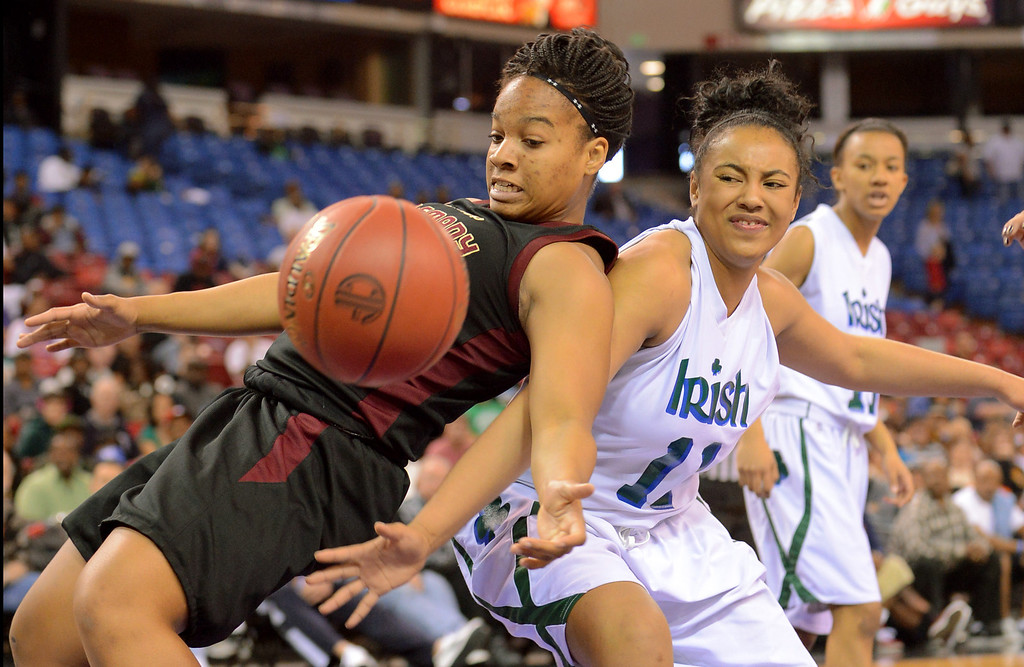 . Alemany High School\'s Jessica Schoew competes for a rebound with Asley Gainer of Sacred Heart Cathedral during the 1st half of their 2013 CIF State Basketball Championship game at the Sleep Train Arena, in Sacramento, Ca March 22, 2013.(Andy Holzman/Los Angeles Daily News)