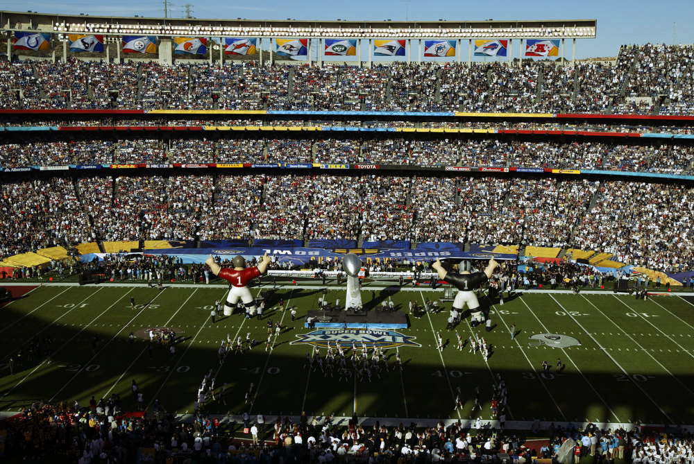 Description of . An overhead view of the interior of Qualcomm Stadium before the start of Super Bowl XXXVII between the Oakland Raiders and the Tampa Bay Buccaneers on January 26, 2003 in San Diego, California.  The Buccaneers won 48-21.  (Photo by Stephen Dunn/Getty Images)