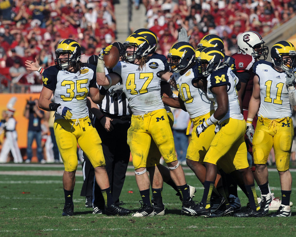 . Linebcaker Jake Ryan #47 of the Michigan Wolverines recovers a fumble against the South Carolina Gamecocks in the Outback Bowl January 1, 2013 at Raymond James Stadium in Tampa, Florida.  (Photo by Al Messerschmidt/Getty Images)