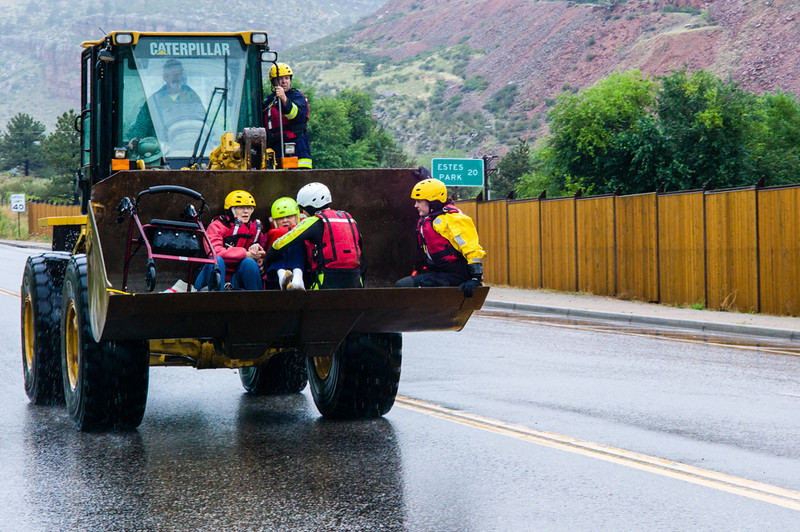 . Evacuation of local Lyons resident by front end loader on Thursday morning the 12th. Photo by Thomas F Woods