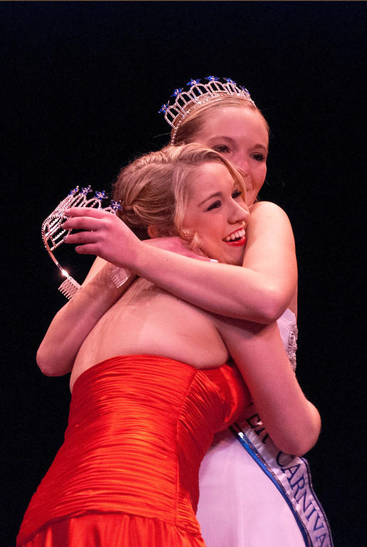 . Kayla Rice/Reformer 2013 Winter Carnival Queen Alison Cornellier passes on the crown to Kara Walsh during the 2014 Brattleboro Winter Carnival Queen\'s Pageant on Friday evening.