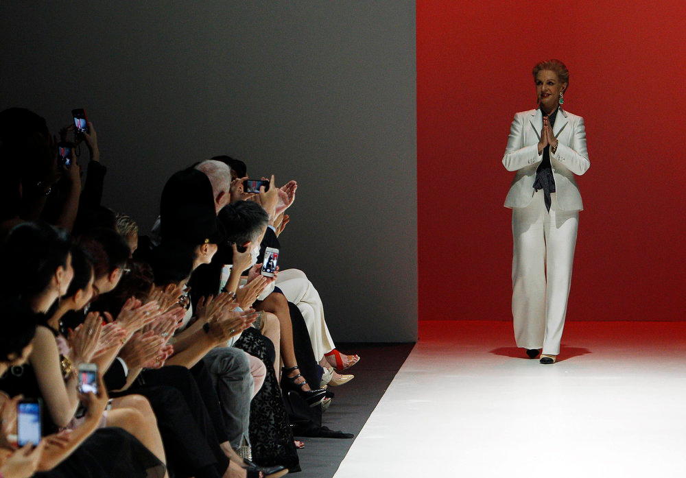 . Fashion designer Carolina Herrera acknowledges the audience at the end of her Autumn/Winter collection fashion show at the Audi Fashion Festival in Singapore May 15, 2013. REUTERS/Edgar Su