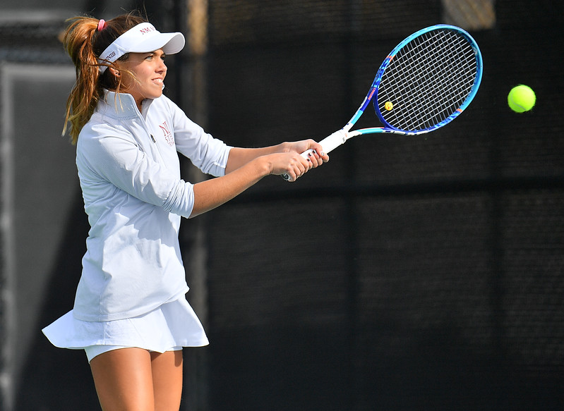 LAS VEGAS, NV - JANUARY 20:  Eli Arnaudova of the New Mexico State Aggies plays a backhand during her team's match against McKenna Lloyd of the Weber State Wildcats at the Frank and Vicki Fertitta Tennis Complex in Las Vegas, Nevada. Amaudova won the match 7-5, 6-2.
