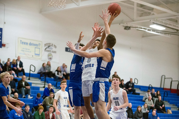 02/11/20 Wesley Bunnell | StaffrrPlainville boys basketball at home on Tuesday night against Lewis Mills. Tyshawn Johnson (5).