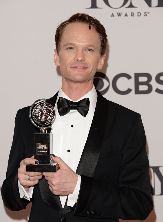 ". Neil Patrick Harris, winner of Tony Award For Best Actor In A Musical for ""Hedwig And The Angry Inch\"" poses in the press room during the 68th Annual Tony Awards on June 8, 2014 in New York City.  (Photo by Andrew H. Walker/Getty Images for Tony Awards Productions)"
