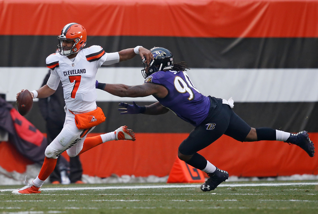 . Cleveland Browns quarterback DeShone Kizer (7) tries to avoid Baltimore Ravens defensive end Za\'Darius Smith (90) during the second half of an NFL football game, Sunday, Dec. 17, 2017, in Cleveland. (AP Photo/Ron Schwane)