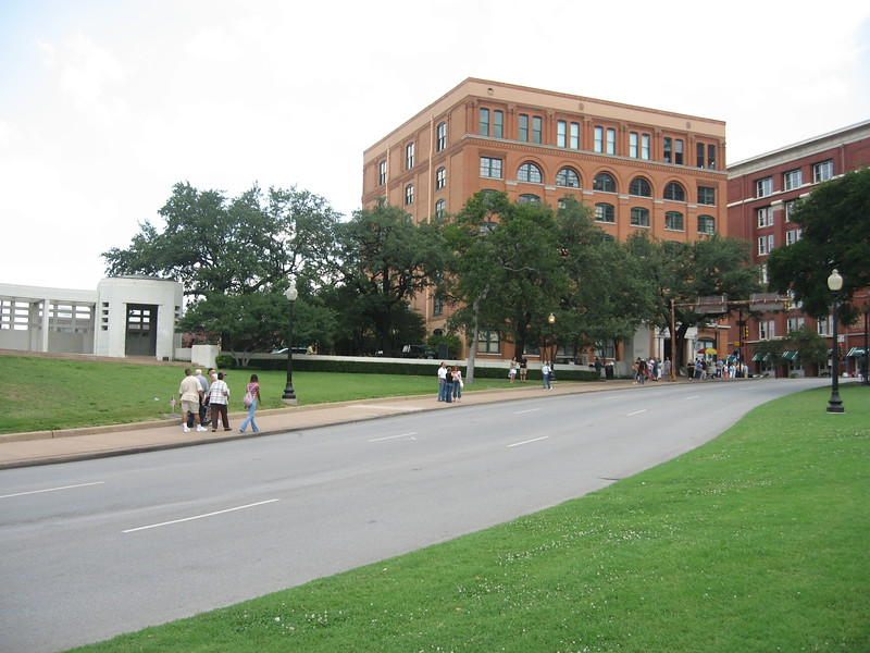 View of the former Texas School Book Depository from the center of Dealey Plaza.  The spot on which the fatal shot hit President Kennedy is near the center of the photo.