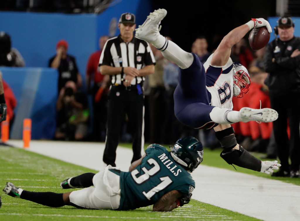 . Philadelphia Eagles cornerback Jalen Mills (31) tackles New England Patriots tight end Rob Gronkowski (87), during the second half of the NFL Super Bowl 52 football game, Sunday, Feb. 4, 2018, in Minneapolis. (AP Photo/Frank Franklin II)
