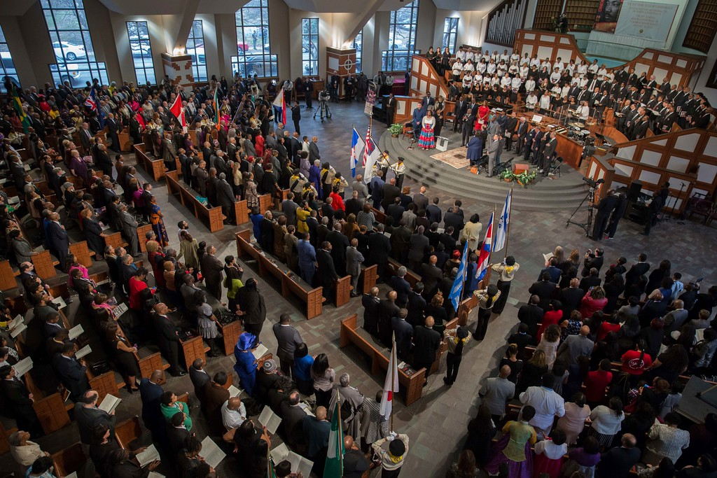 . People attend the Rev. Martin Luther King Jr. commemorative service at Ebenezer Baptist Church, Monday, Jan. 16, 2017, in Atlanta. (AP Photo/Branden Camp)