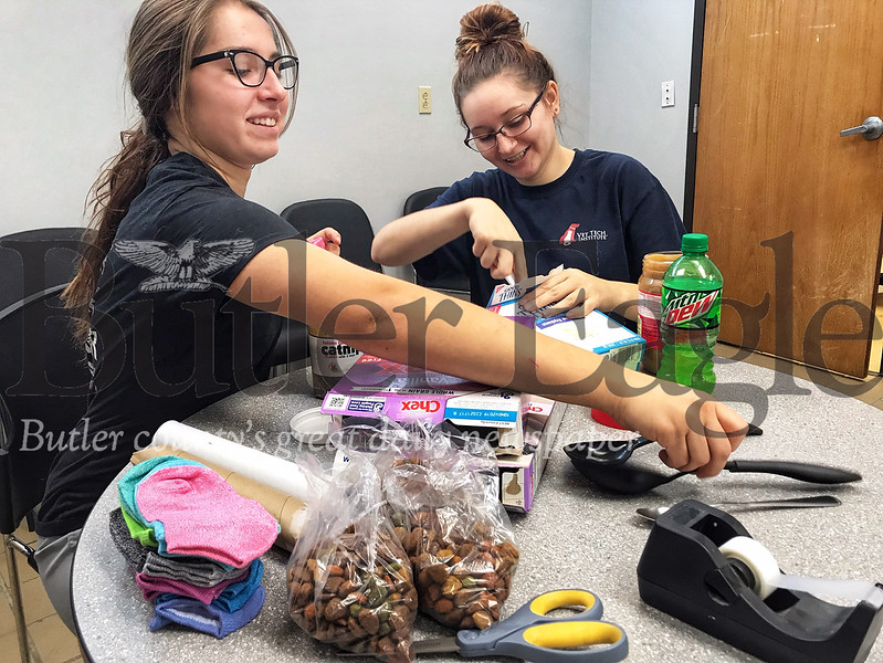 Kennel assistants Audrey Stewart, 19,  and Bri Murphy, 20, make homemade cat and dog treats for Valentine's Day at the Butler County Humane Society. Stewart said she gives her dog spray cheese as a Valentine's Day treat.