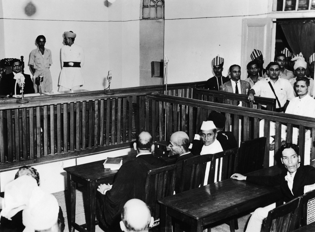 . Nathuram Vinayak Godse, bottom right, on trial for the assassination of Mahatma Gandhi in the red fort, Old Delhi, 27th May 1948. The presiding judge Atma Charan is on the left. (Photo by Fox Photos/Hulton Archive/Getty Images)