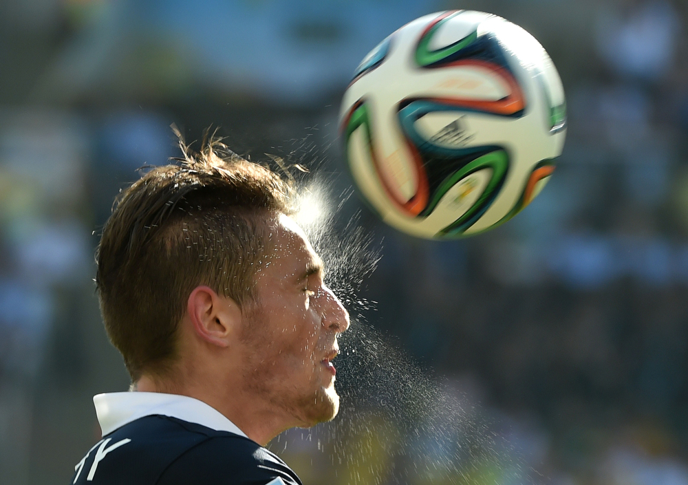 . France\'s defender Mathieu Debuchy heads the ball during a quarter-final football match between France and Germany at the Maracana Stadium in Rio de Janeiro during the 2014 FIFA World Cup on July 4, 2014. (YASUYOSHI CHIBA/AFP/Getty Images)