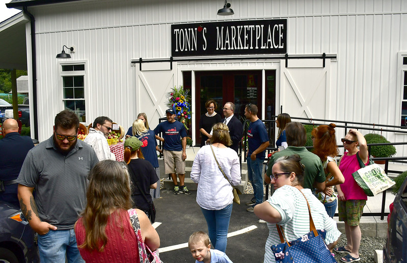 9/5/2019 Mike Orazzi | Staff The ribbon officially opening Tonn's Marketplace on the Bristol Burlington line on Thursday afternoon.