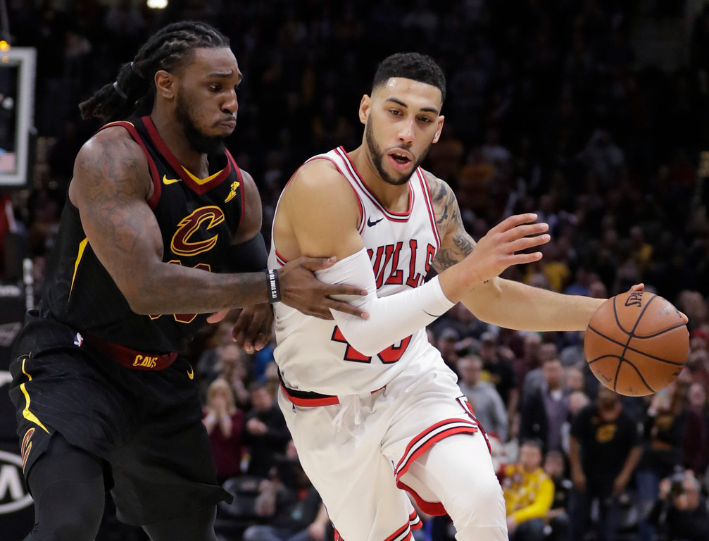 . Chicago Bulls\' Denzel Valentine, right, drives past Cleveland Cavaliers\' Jae Crowder during the second half of an NBA basketball game Thursday, Dec. 21, 2017, in Cleveland. The Cavaliers won 115-112.(AP Photo/Tony Dejak)