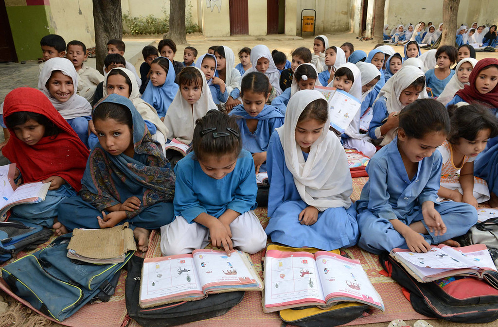 . Pakistani girls attend class at a school in Mingora, a town in Swat valley, on October 9, 2013, the first anniversary of the shooting of Malala Yousafzai by the Taliban. Yousafzai, the teenage activist nominated for the Nobel Peace Prize, says she has not done enough to deserve the award, as her old school closed October 9 to mark the first anniversary of her shooting by the Taliban.   A Majeed/AFP/Getty Images