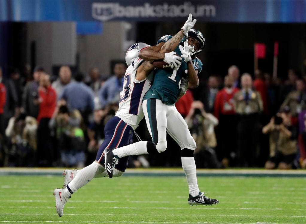 . Philadelphia Eagles wide receiver Nelson Agholor (13) makes a catch against New England Patriots strong safety Patrick Chung (23), during the second half of the NFL Super Bowl 52 football game, Sunday, Feb. 4, 2018, in Minneapolis. (AP Photo/Chris O\'Meara)