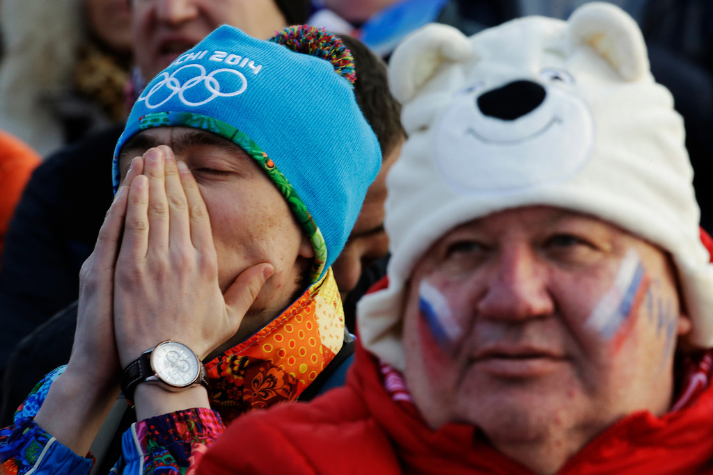 . Fans watch the men\'s ice hockey game between Russia and Finland on a large screen in Olympic Park, at the 2014 Winter Olympics, Wednesday, Feb. 19, 2014, in Sochi, Russia. (AP Photo/Morry Gash)
