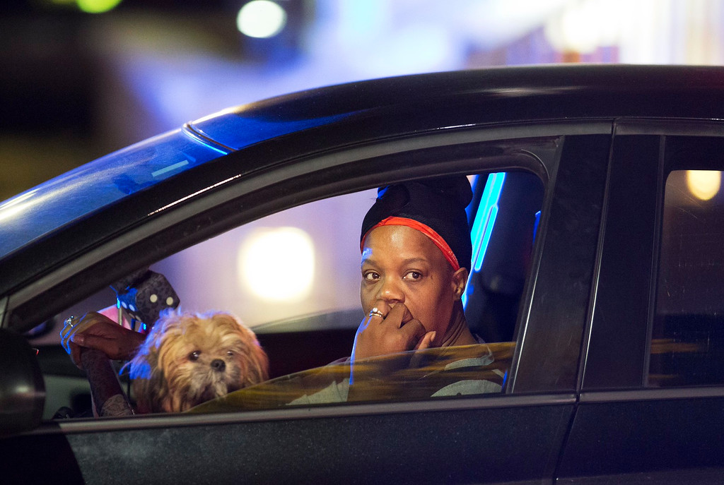 . A passing motorist looks out her window as she stops at an intersection down the street from the Emanuel AME Church early Thursday, June 18, 2015 following a shooting Wednesday night in Charleston, S.C. (AP Photo/David Goldman)