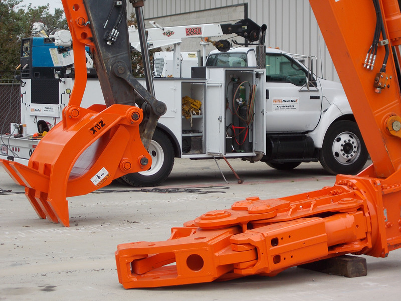 NPK M35K demolition shear on Hitachi excavator and demolition grapple at DemoTrax.jpg