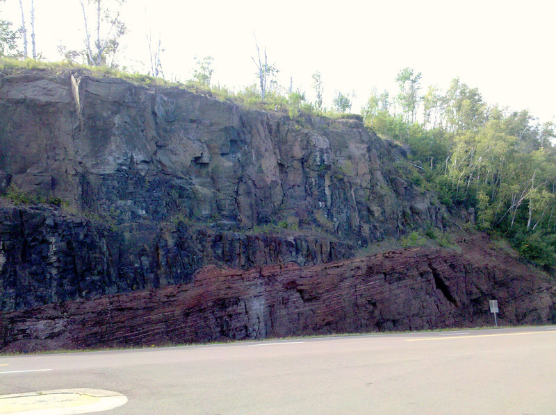 The outcropping the geological maker south of Grand Marais, MN on Rt 61 refers to.