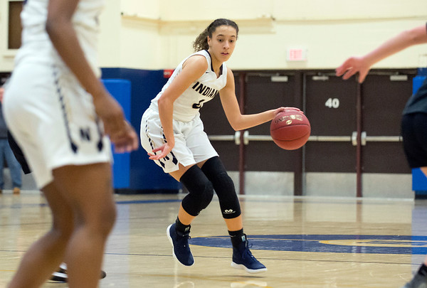 02/20/20 Wesley Bunnell | StaffrrNewington girls basketball defeated Enfield on thursday night at home in the first round of the conference tournament. Alexi Armour (4) looks downcourt to pass.