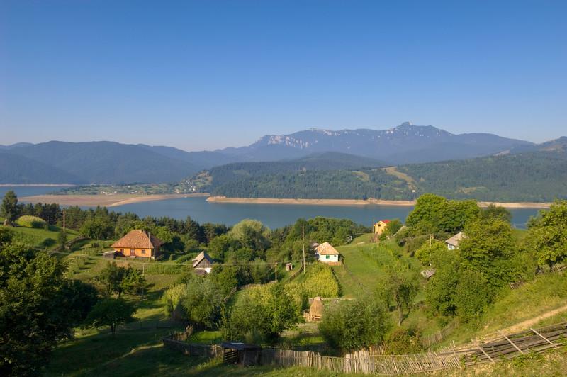 Ruginesti village overlooking Bicaz Lake and Ceahlau Massif, Moldavia, Romania
