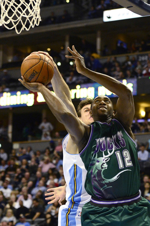 . DENVER, CO - FEBRUARY 5: Danilo Gallinari Denver Nuggets (8) blcoks Luc Mbah A Moute Milwaukee Bucks (12) during the first half. The Denver Nuggets take on the Milwaukee Bucks in NBA action. (Photo By AAron Ontiveroz/The Denver Post)