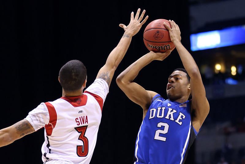 . Quinn Cook #2 of the Duke Blue Devils attempts a shot in the first half against Peyton Siva #3 of the Louisville Cardinals during the Midwest Regional Final round of the 2013 NCAA Men\'s Basketball Tournament at Lucas Oil Stadium on March 31, 2013 in Indianapolis, Indiana.  (Photo by Streeter Lecka/Getty Images)