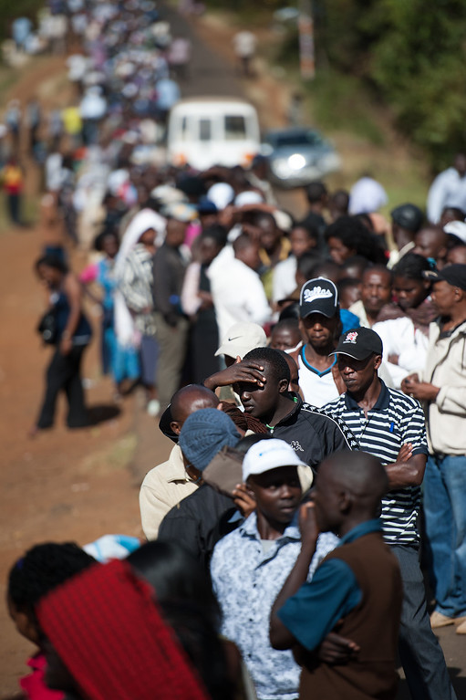 . Voters queue to cast their ballot at St. Matthews Church in the Langata constituency of the Kenyan capital, Nairobi, on March 4, 2013 during the Kenyan elections. Long lines of Kenyans queued from far before dawn to vote Monday in the first election since the violence-racked polls five years ago, with a deadly police ambush hours before polling started marring the key ballot. The tense elections are seen as a crucial test for Kenya, with leaders vowing to avoid a repeat of the bloody 2007-8 post-poll violence in which over 1,100 people were killed, with observers repeatedly warning of the risk of renewed conflict.     PHIL MOORE/AFP/Getty Images