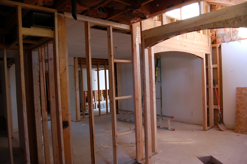 Looking from the master bath into the master bedroom and, through the hole in the drywall, the hallway (in the center of the photo).