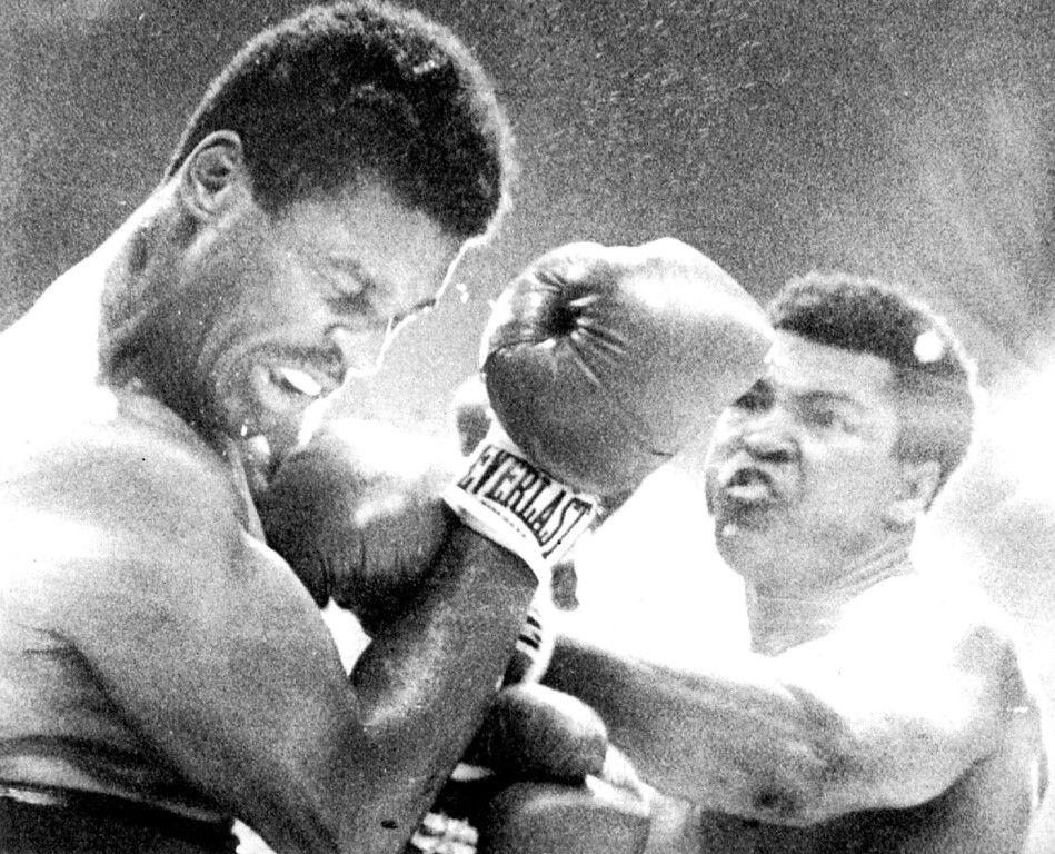 . Ali Connects--Heavyweight Champion Muhammad Ali connects with a left to the face of Jimmy Young during their championship bout at Landover Friday. Ali won a unanimous decision in fifteen rounds. 1976. Credit: AP Wirephoto