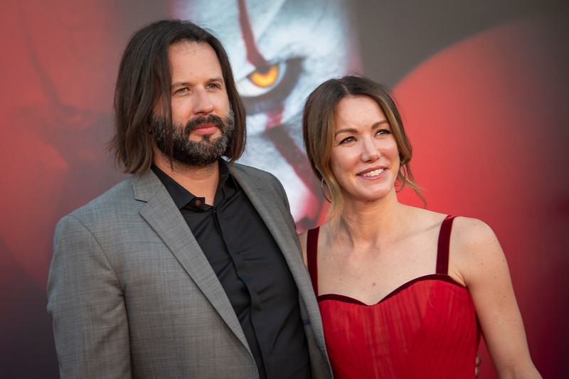 """WESTWOOD, CA - AUGUST 26: Gary Dauberman and Sara Dauberman attend the Premiere Of Warner Bros. Pictures' """"It Chapter Two"""" at Regency Village Theatre on Monday, August 26, 2019 in Westwood, California. (Photo by Tom Sorensen/Moovieboy Pictures)"""