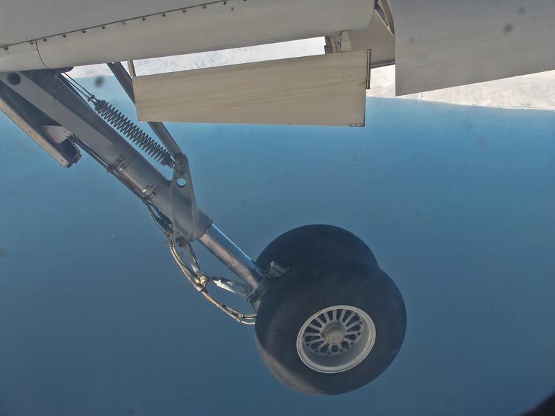 Landing gear being deployed in preparation for landing.