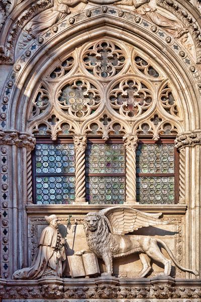The Winged Lion and the Doge Francesco Foscari statues on the top of Porta della Carta Gate, Palazzo Ducale, Venice, Italy