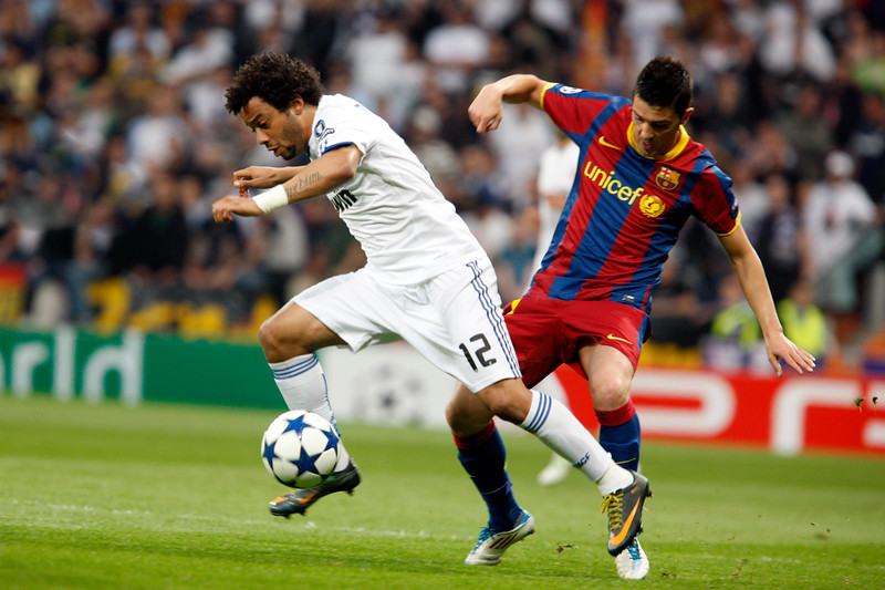 Marcelo pursued by Villa, UEFA Champions League Semifinals game between Real Madrid and FC Barcelona, Bernabeu Stadiumn, Madrid, Spain