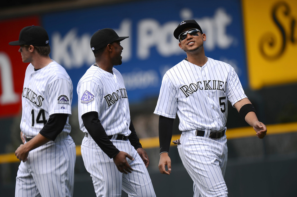 . Carlos Gonzalez (5) of the Colorado Rockies and Chris Nelson (4) of the colorado Rockies talk during warm ups before the start of the game.  (Photo by Hyoung Chang/The Denver Post)