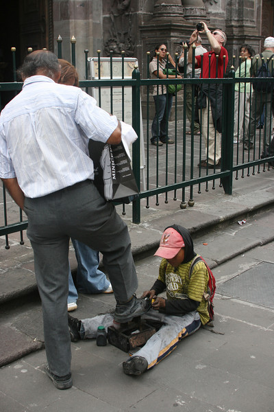 Child labor - shining shoes in Quito.